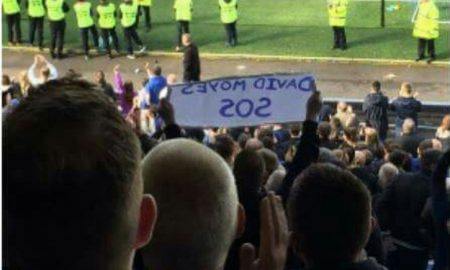 A fan demanding the return of Moyes to Everton
