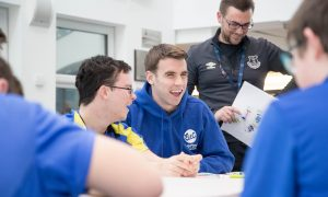 Seamus Coleman sits down with participants from Everton in the Community...