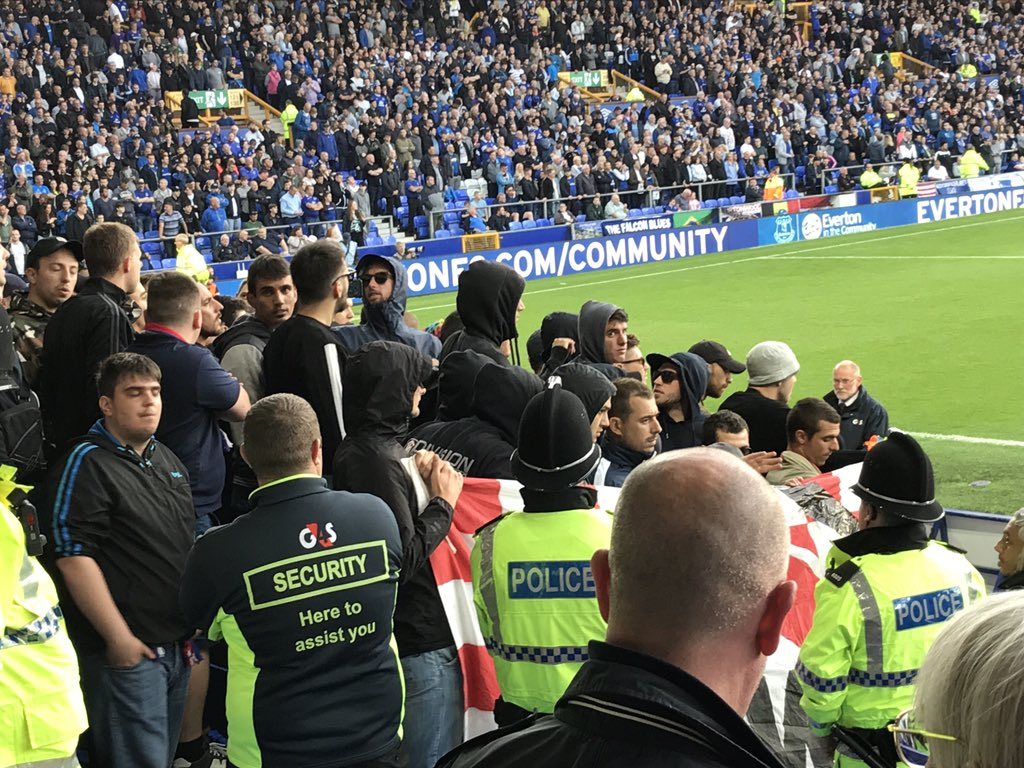 Shocking moment footie hooligans hurl chairs during Everton Europa League match